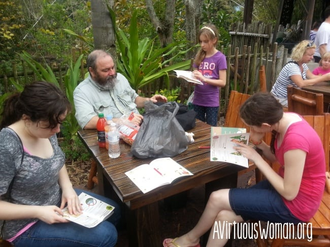 Working on our Wilderness Explorer badges at Disney's Animal Kingdom. @ AVirtuousWoman.org #disney