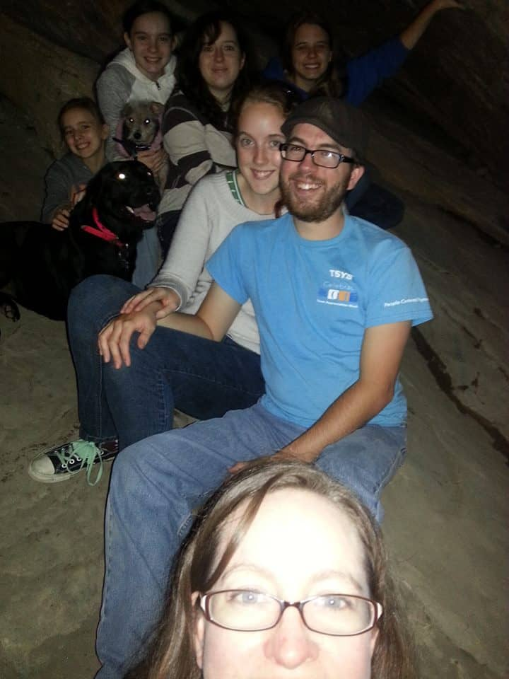 "Me, with my kids after we crawled up a slick rock into a ""cave like"" place in a rock. Trying to take a group ""selfie."""