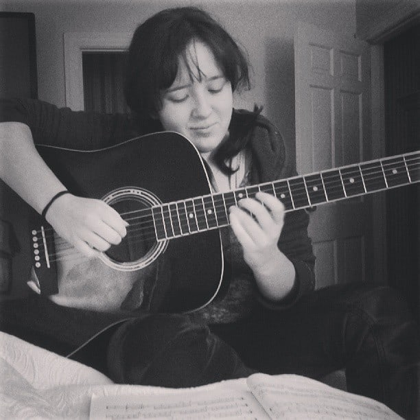Emily with her guitar.