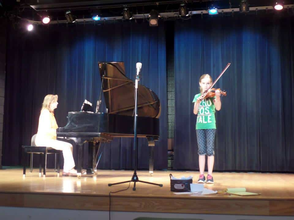 Laura practicing for her violin recital in 2014.